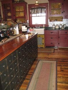this house is amazing!! I love all those little drawers, so neat!
