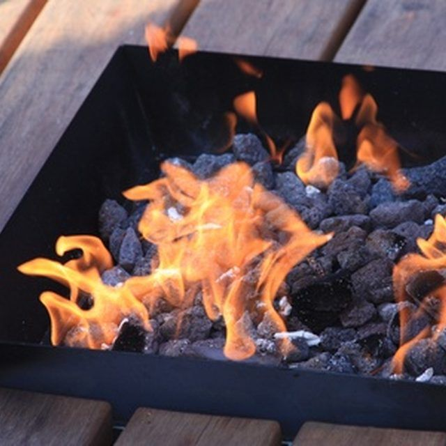 A decorative planter and ceramic bowl would make this fire bowl appealing
