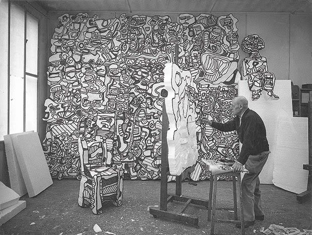 Jean Dubuffet at work on a polystyrene sculpture in Paris, 1967.