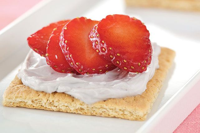 Here's a yummy and better-for-you shortcut to cheesecake nirvana—made withlight cream cheese spread, graham crackers and sliced fresh strawberries.