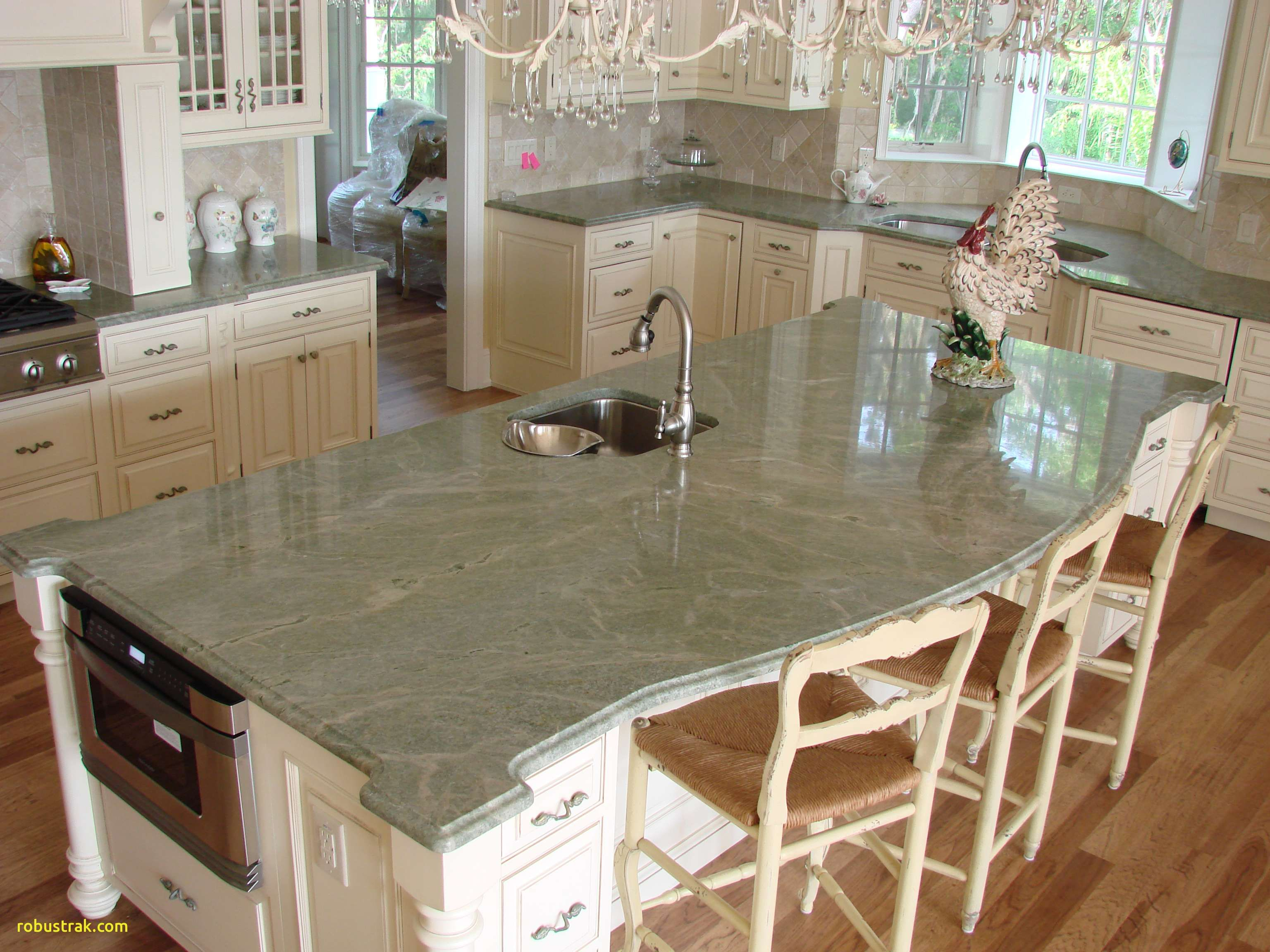 8 Popular Countertop Materials The Pros And The Cons Granite Countertops Kitchen Marble Kitchen Island Green Granite Countertops