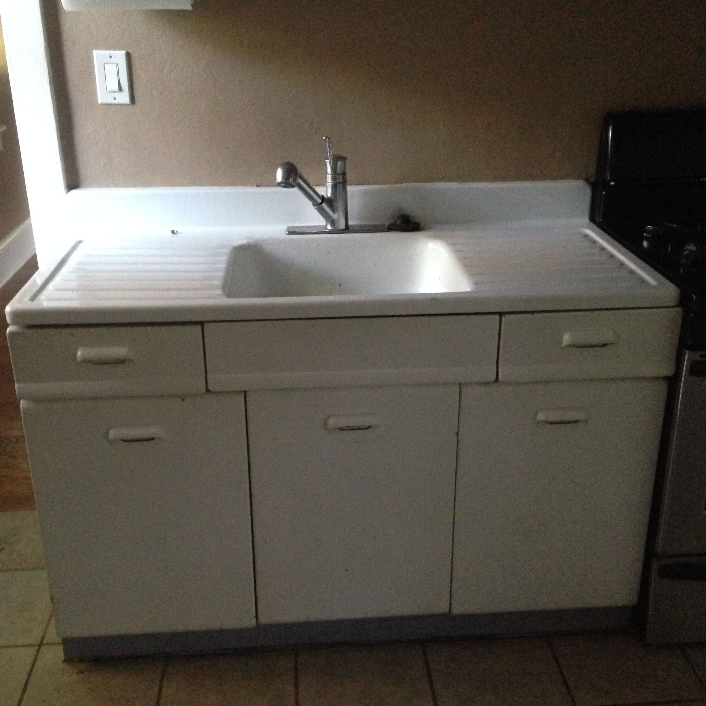 My 1940's drain board sink will put new pulls and new paint.  Love that the cabinets and drawers are metal.