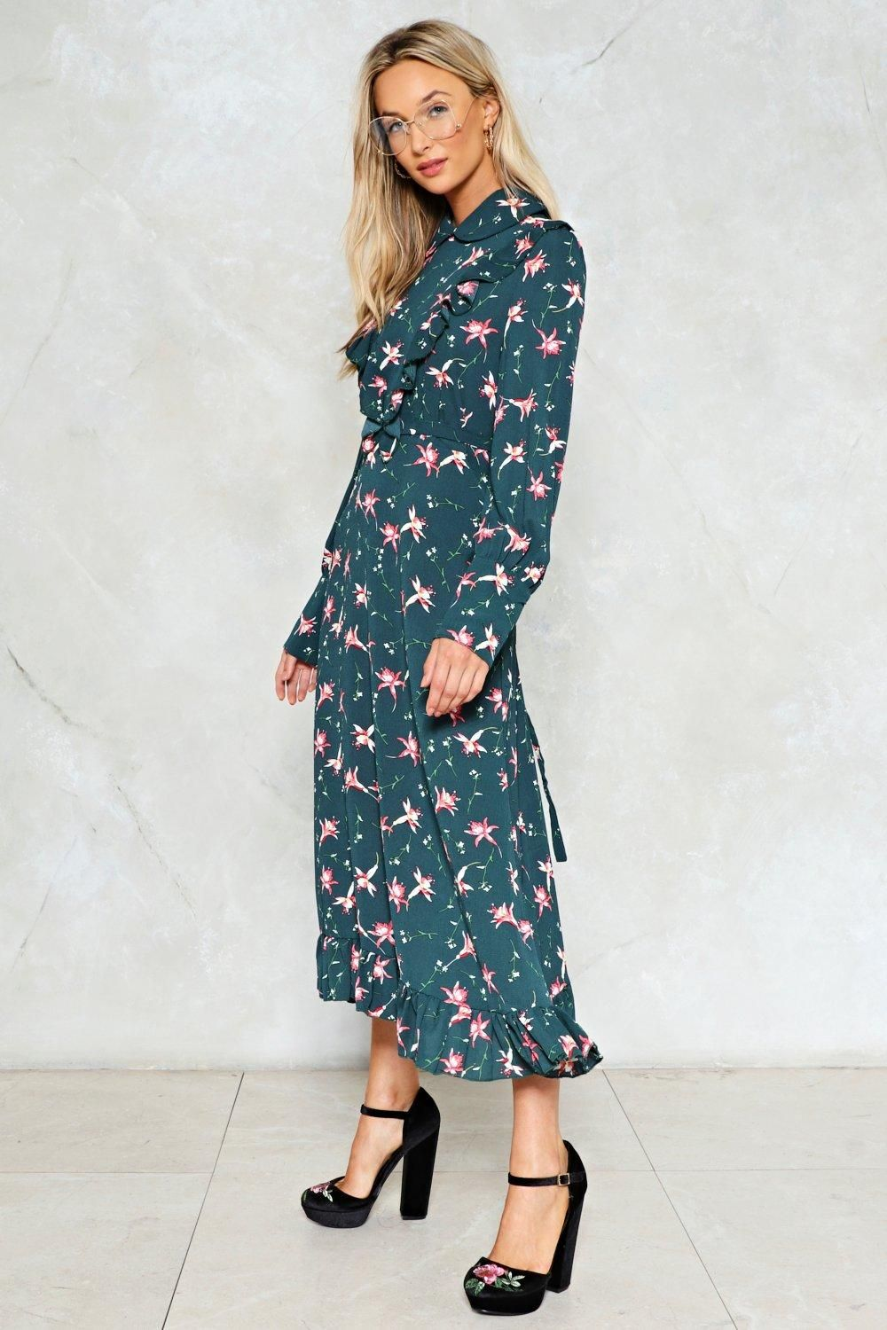 adb961b4e138e The You ll Grow a Long Way Dress features a floral print throughout