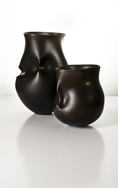 Hipped. A pair of porcelain vessels created by Sara Flynn.