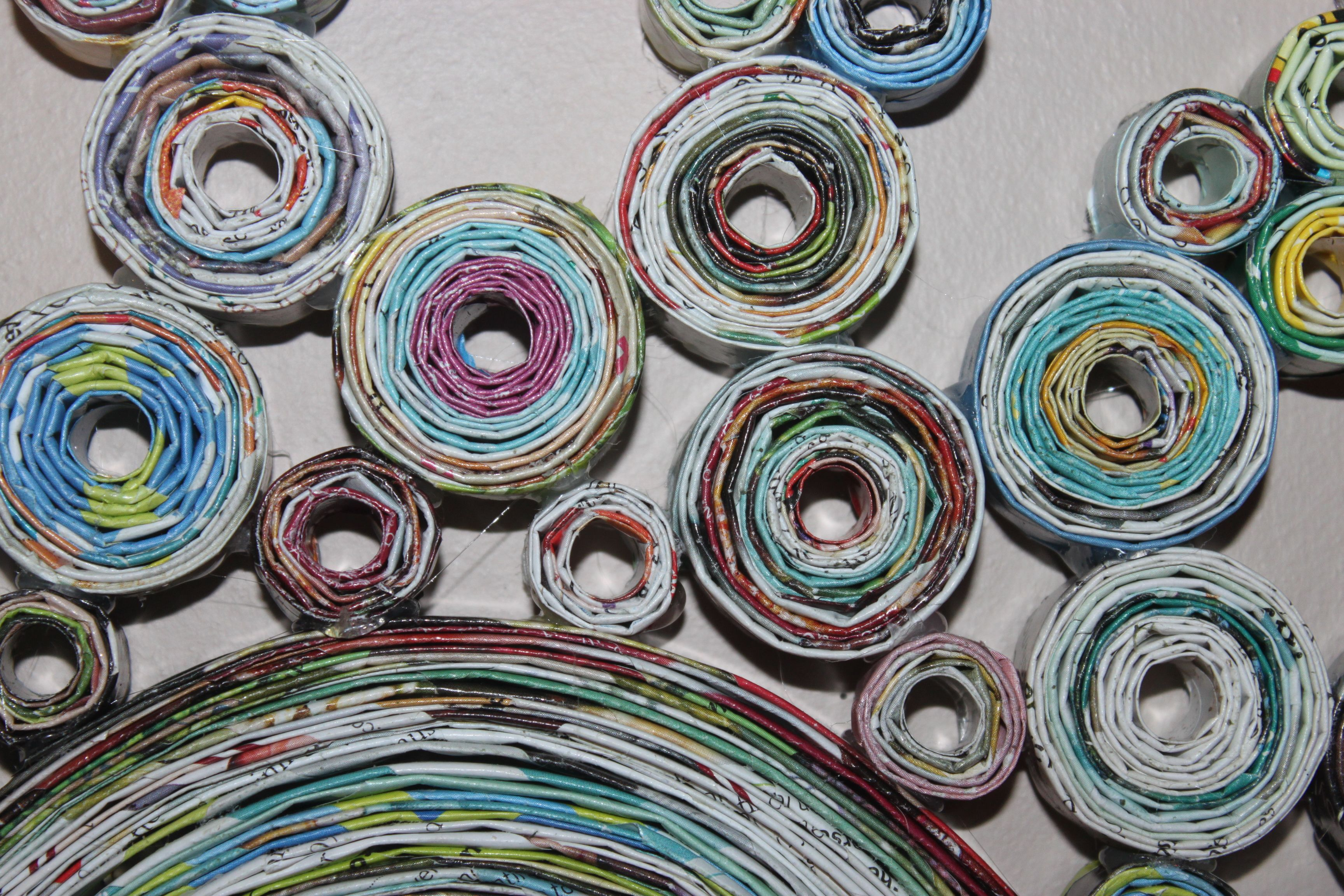 rolled paper art close up. made from magazine pages