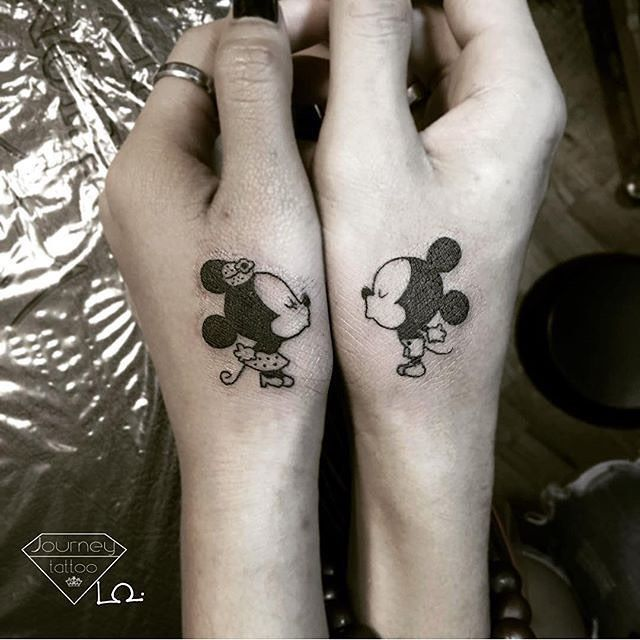 Cute little couple's tattoo from @loi_journeytattoo #HappyBirthdayMickeyMouse #inkaddict #inkaddictnation #mickeymousetattoo