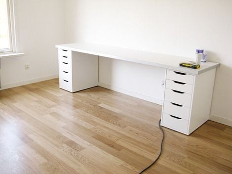 Ikea Desk Did A Version Of This Using Two 4 5 Desks Side By Metal Legs On Each End And One Drawer Unit Shown To Support Where The Come