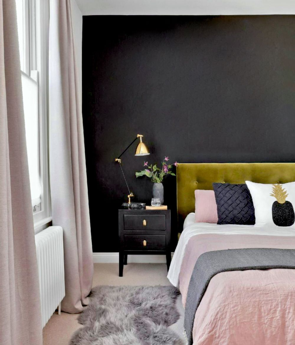 Black feature wall in bedroom, olive green headboard and