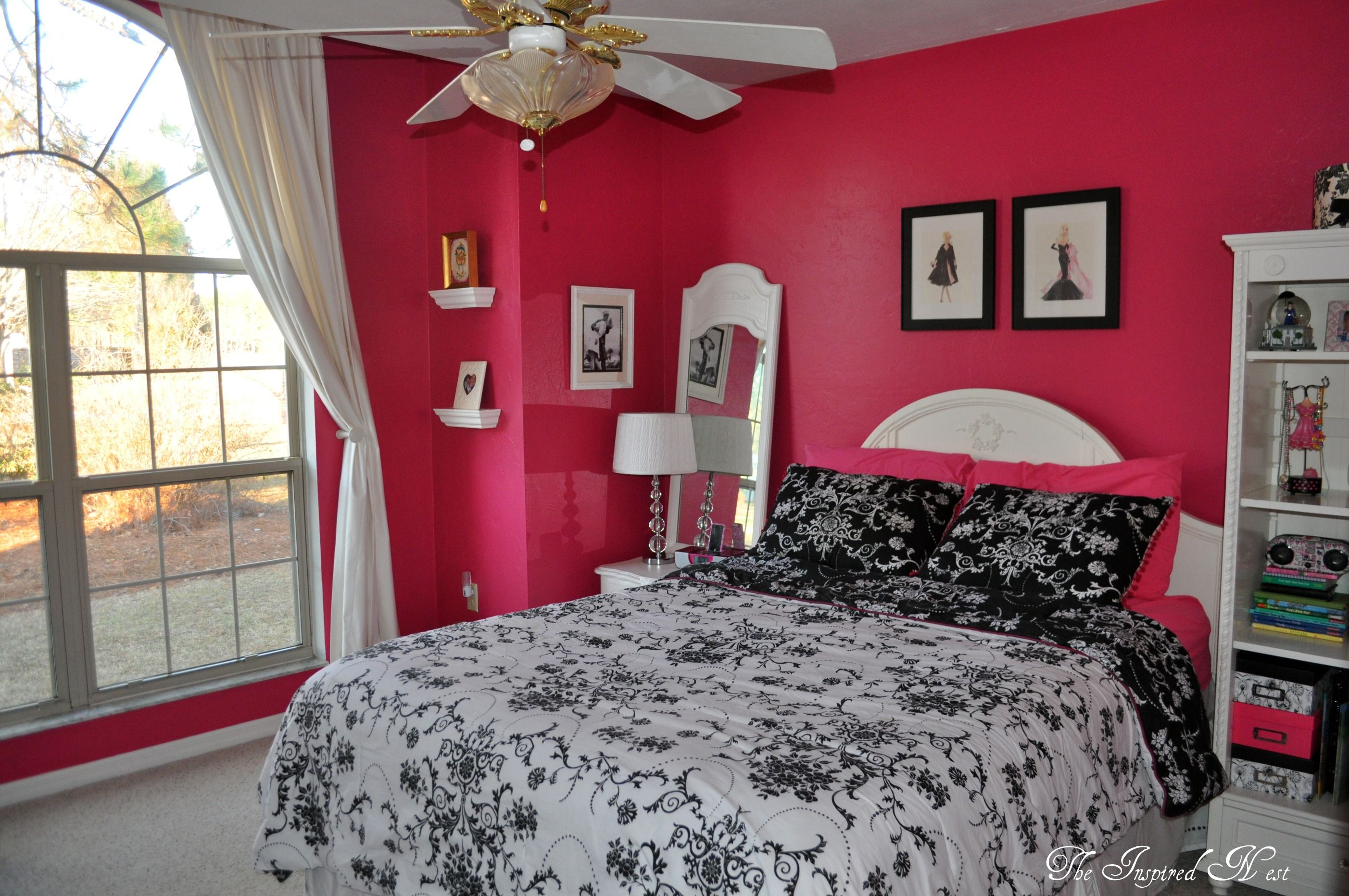 Hot pink walls add a stark contrast for the black and ...