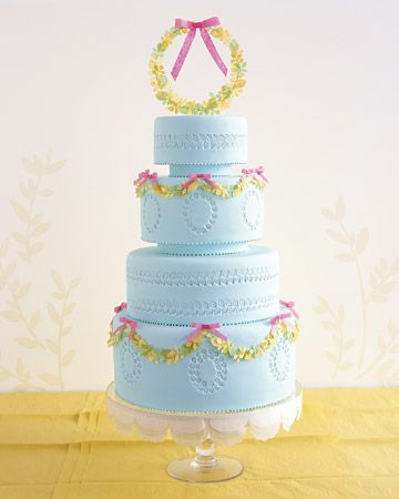 The garlands of tiny leaves and delicate paper bows on this pale-blue cake are surprisingly easy to make