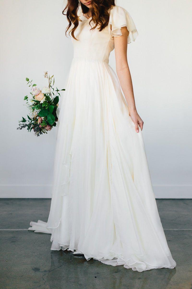Modest wedding dress with a flowy bottom from alta moda bridal in
