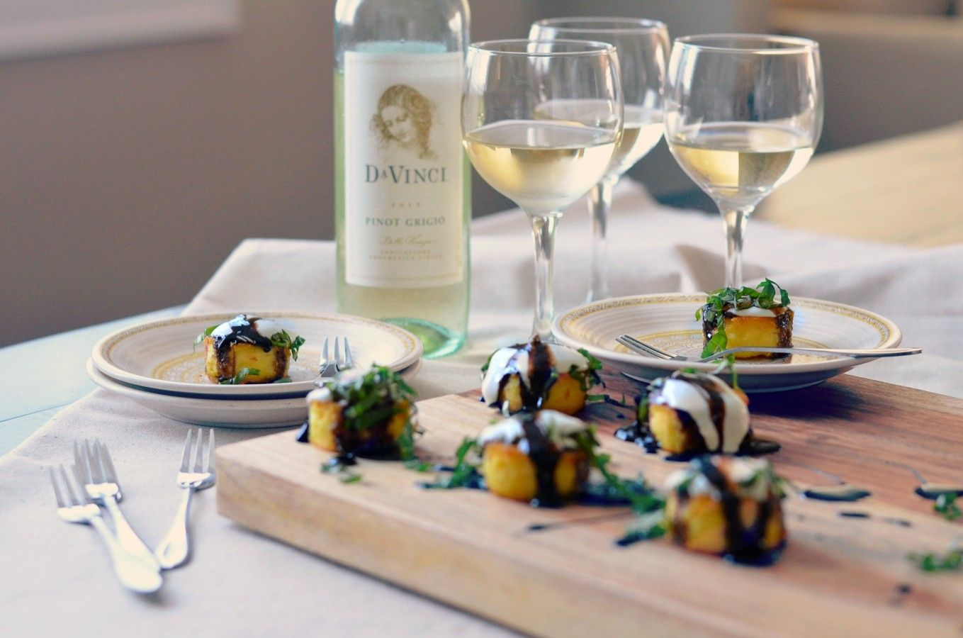 Crispy Polenta Bites with Creme Fraiche, Balsamic Glaze and Fresh Basil with DaVinci Pinot Grigio