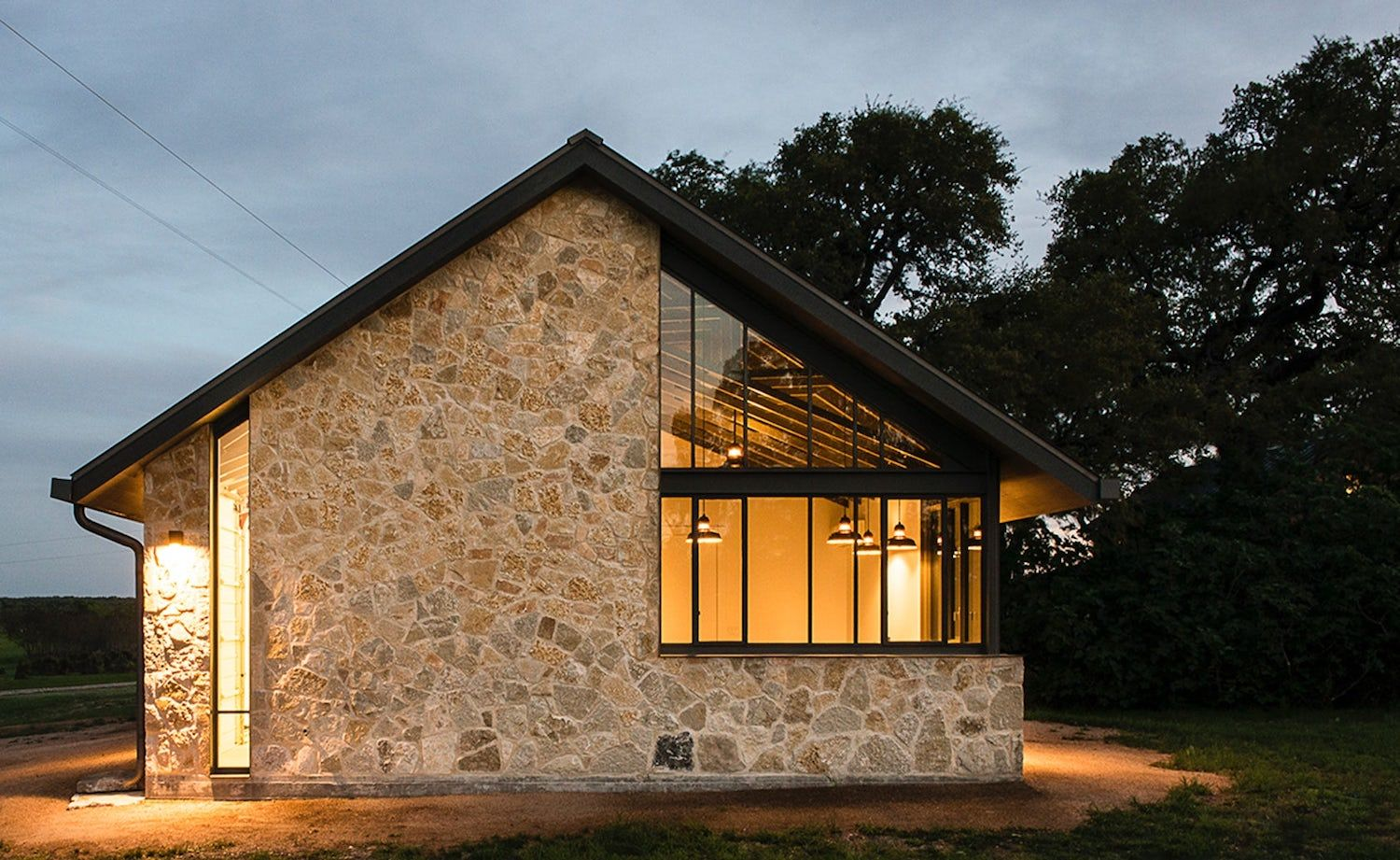 Modern Barn Which Is The Companion Building To A Small Stone Ranch House Caandesign Architecture And Ho Stone House Plans Stone Exterior Houses Modern Barn