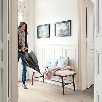 Use light wood flooring to lighten and brighten small spaces like entrances and hallways.