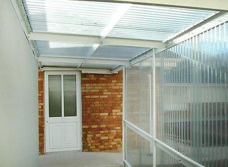 Vs cerramientos de policarbonato cristales patio for Toldos para patios pequenos