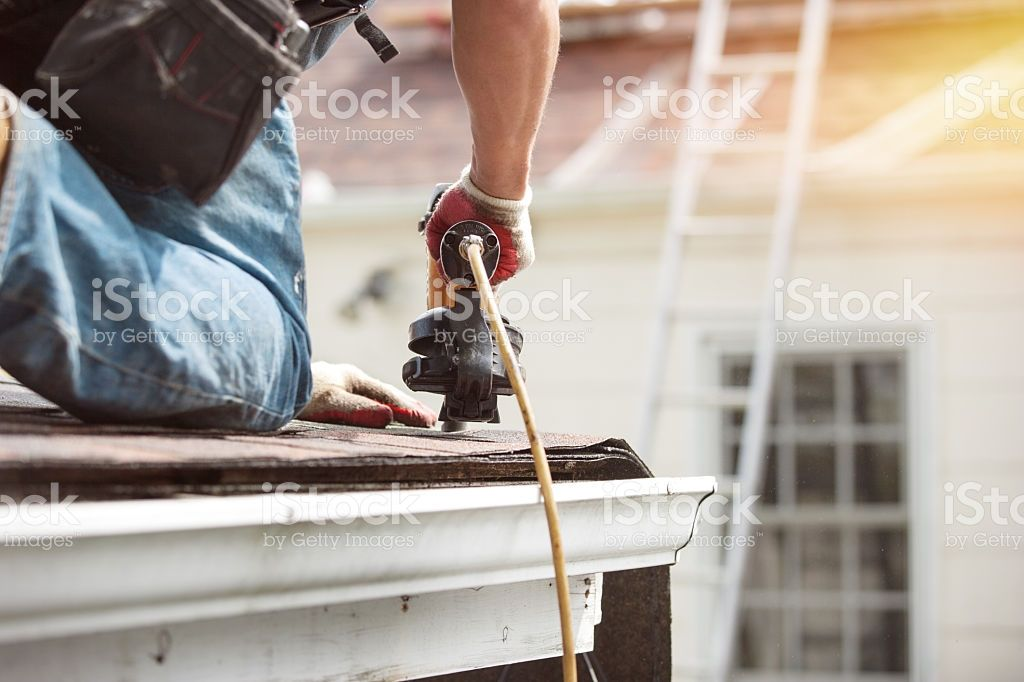 roofers installing a new roof on residential home