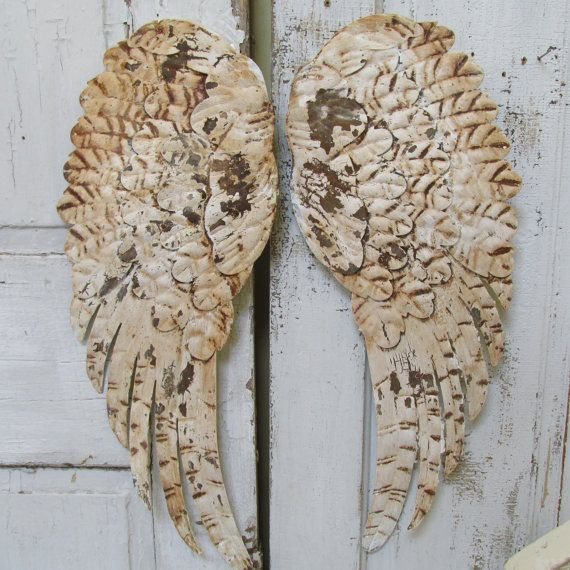 Large metal wings wall decor shabby chic white rusted distressed hand painted by anita spero    These are thin metal wings. They sit very flat