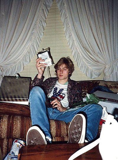 Credit: AP A teenaged Kurt Cobain opens presents