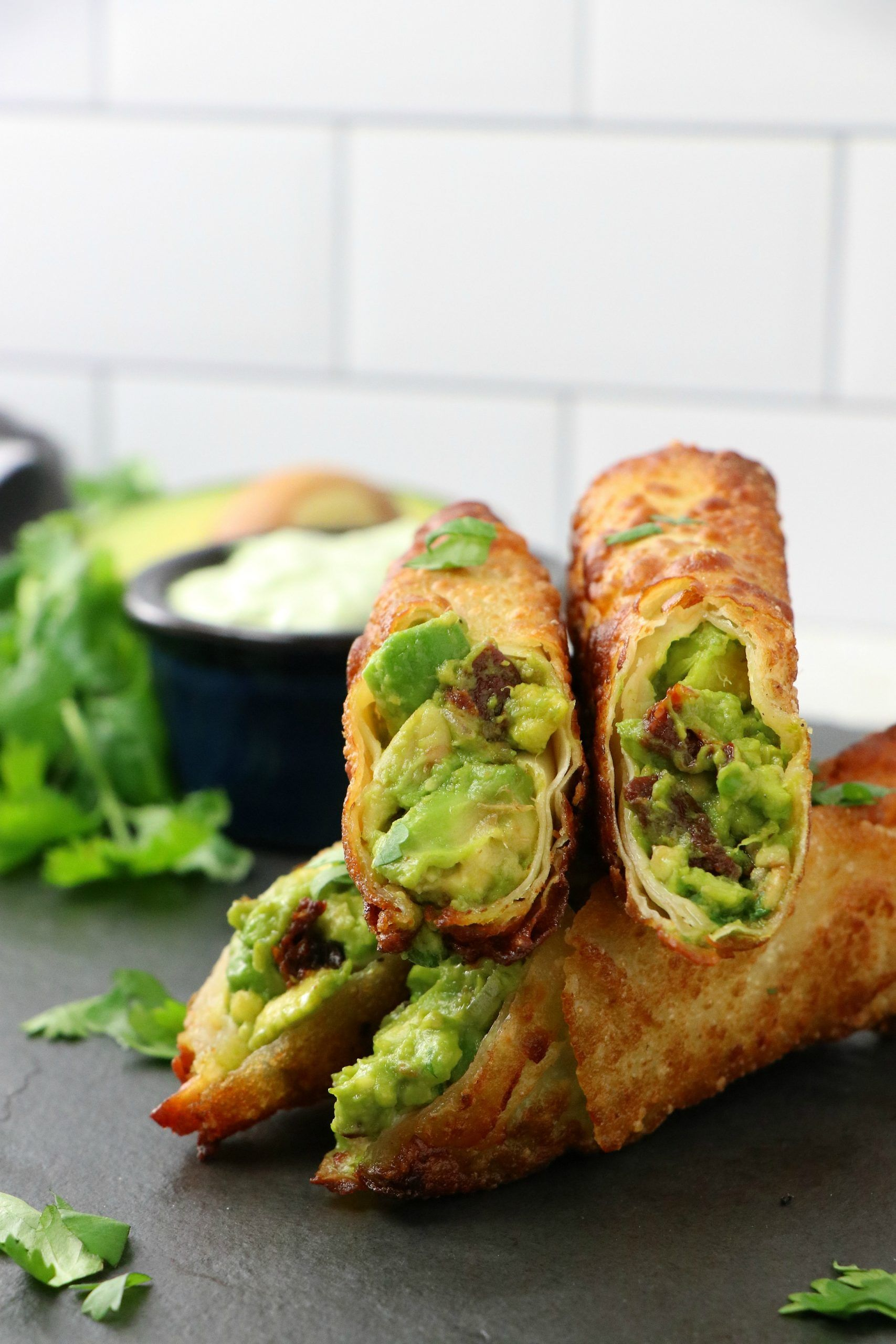 Hello & Happy Thursday!!      We've been going down the list creating effortless vegan 4th of July concepts. As I sat and brainstormed about what the next recipe should be, I thought about my bucket list and my mind immediately went to.. Avocado Egg Rolls! While I like to keep fried concepts to a minimum on EDS, there are a few staples you just have experience and one of them is this re