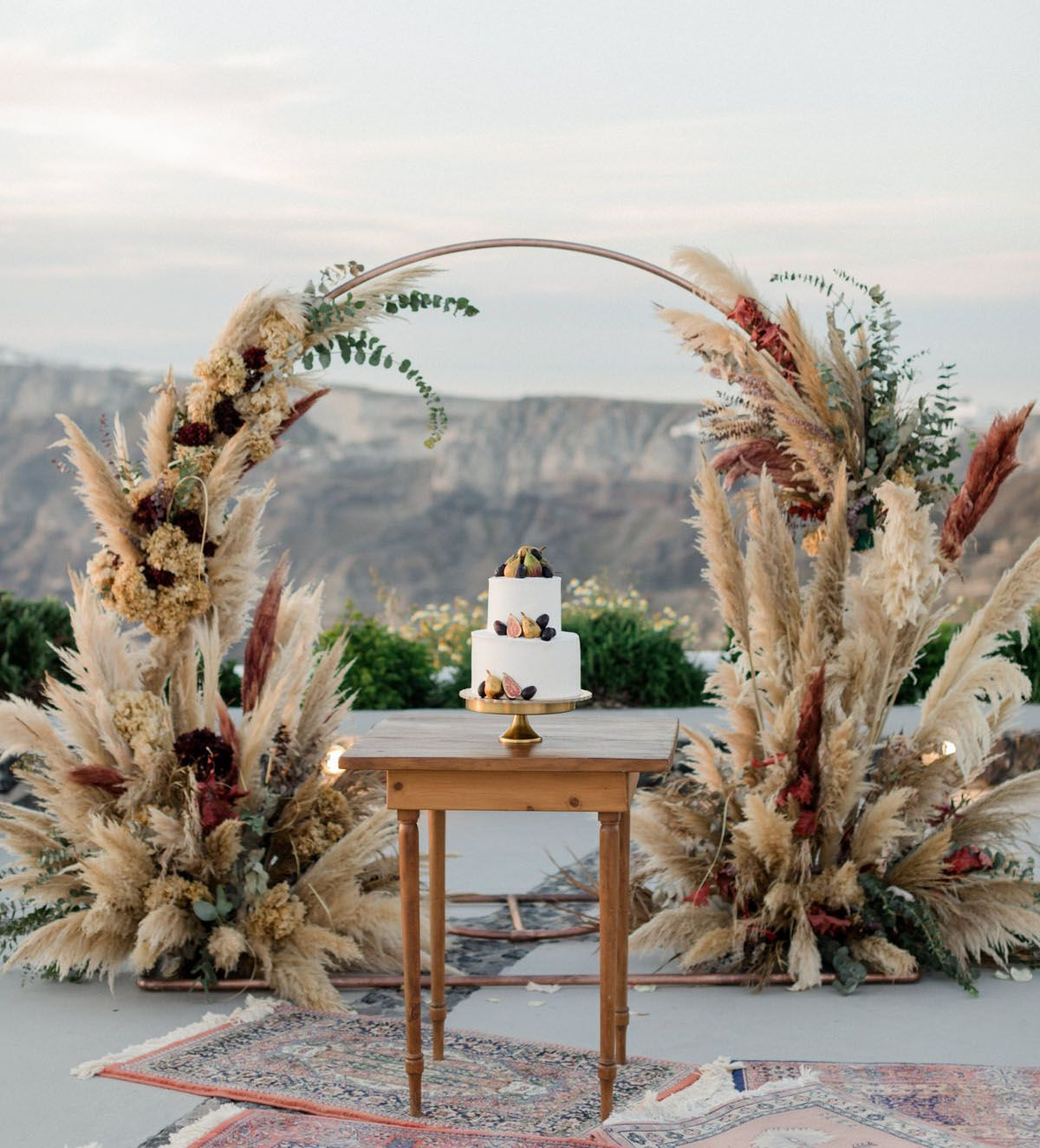Cliffside Winery Wedding in Santorini with Romantic Pampas Grass Decor | Green Wedding Shoes