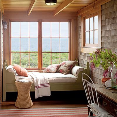 Create a Cozy Nook  Even seldom-used areas of the home can be cozied-up. The addition of a daybed turned this pass-through porch nook into a comfortable destination for curling up with a good book. Throw pillows with plenty of texture warm up the cotton duck mattress cover.