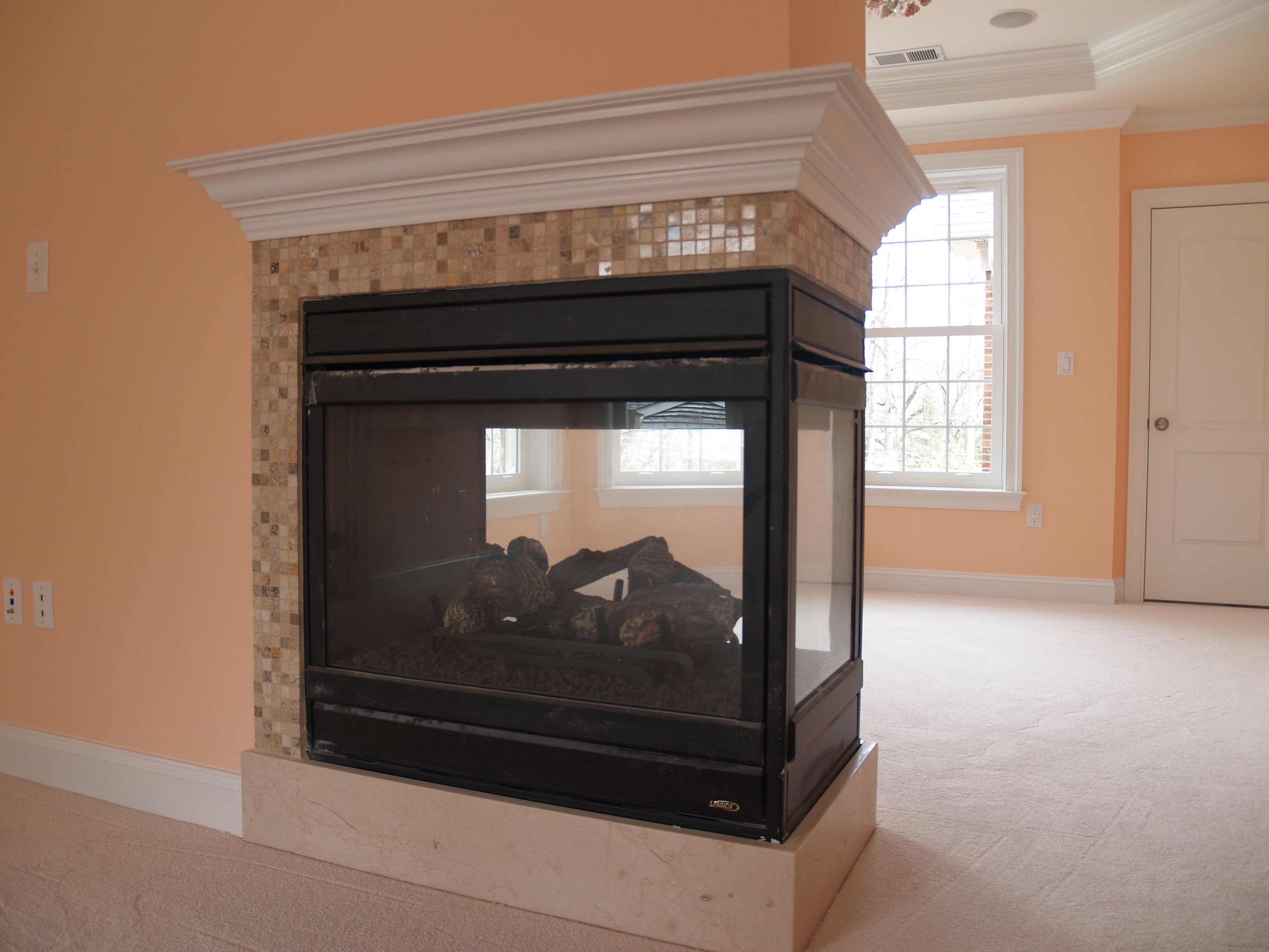 Three sided gas fireplace model EDVPF by Lennox Hearth products ...
