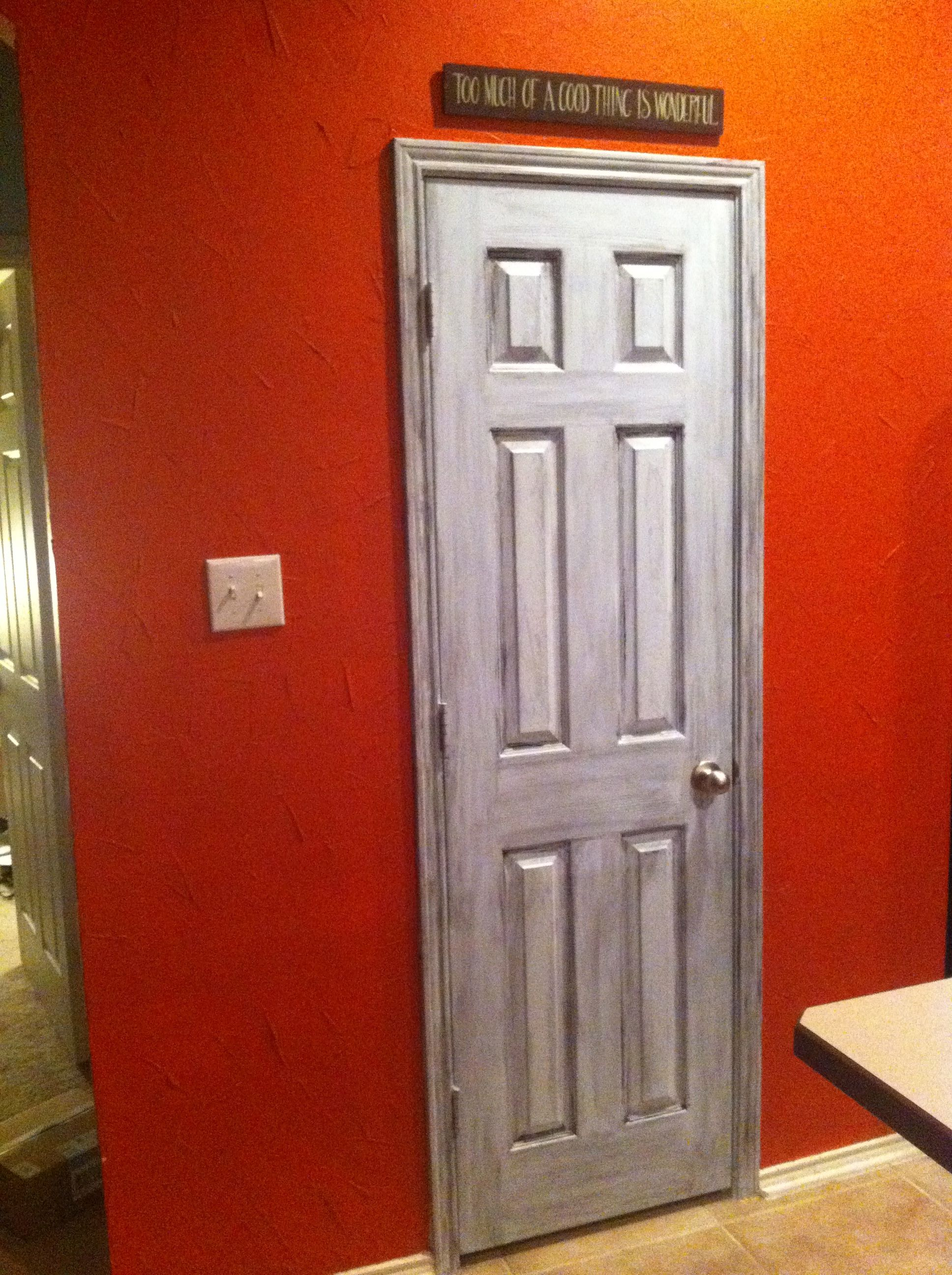 My newly painted pantry door!    Base Color - Behr Mineral Water Blue  Glaze - Behr Lamp Black  Both colors in satin finish