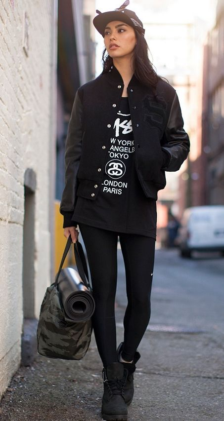 All black everything. Varsity jacket gives it some edge while the yoga mat  let us know she can get zen. e7614f02fac