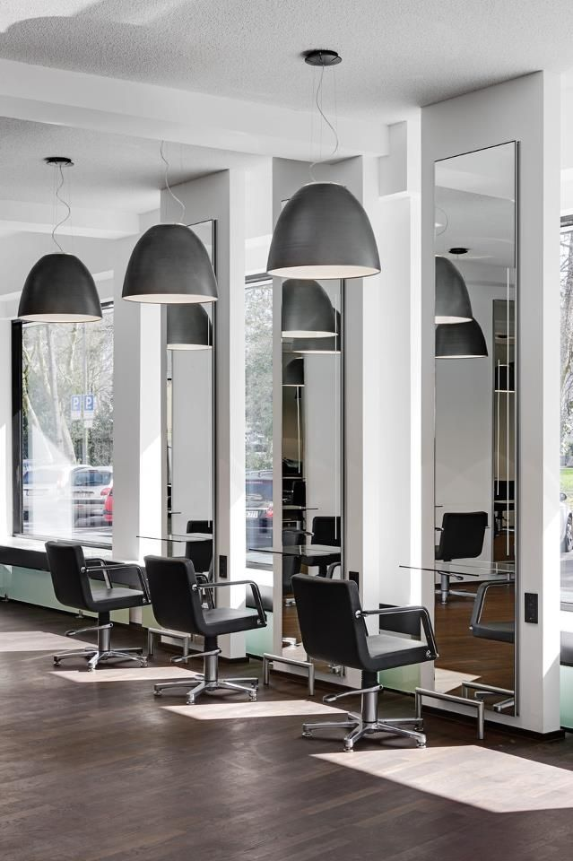 Modern salon with modern makeup chairs and hairstylist chairs