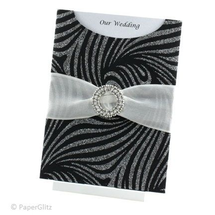 MOONSHADOW  This wedding invitation features a C6 Glamour Pocket in Venus Black Silver Glitter. It is finished with a stunning opaque white 40mm Parasilk ribbon and gorgeous Round Dual Layer diamante Buckle for loads of bling! The insert is printed on Ice Gold card and simply slides out to reveal your special announcement. Price:$7.25 https://www.facebook.com/NextChapterWeddingInvitations