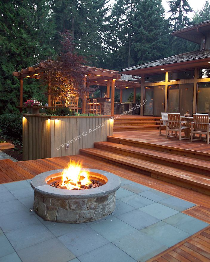 A 1700 Square Foot 2 Level Deck Outdoor Kitchen And Firepit Complete The Outside Of This Ranch Style Hom Deck Designs Backyard Backyard Patio Decks Backyard