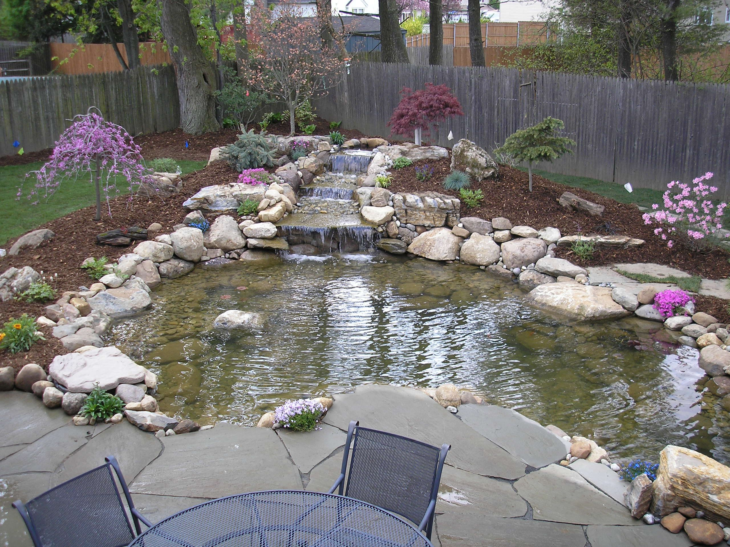 Beautiful this is the design i would pick i would just for Backyard koi pond ideas