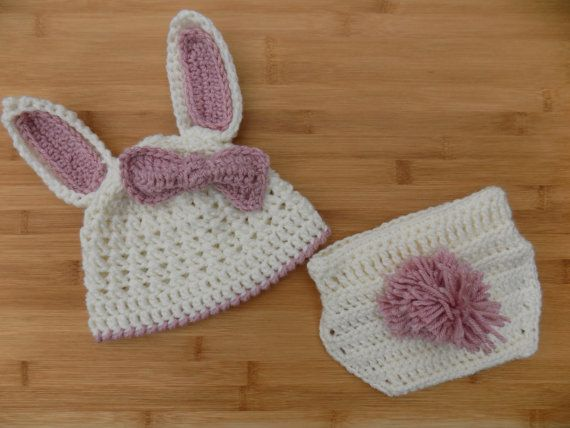 This Bunny Outfit is the perfect newborn- 3 mo. picture prop for any spring baby you know! The diaper cover is adjustable. This set will be crocheted in a smoke free home. May contain choking hazards (small buttons)  Feel free to contact me for more information, sizing requests, or special requests and I will see what I can do!  Size: Infant/Newborn Colors: White and Pink  Caring For Your New Purchase: Hand wash and air dry