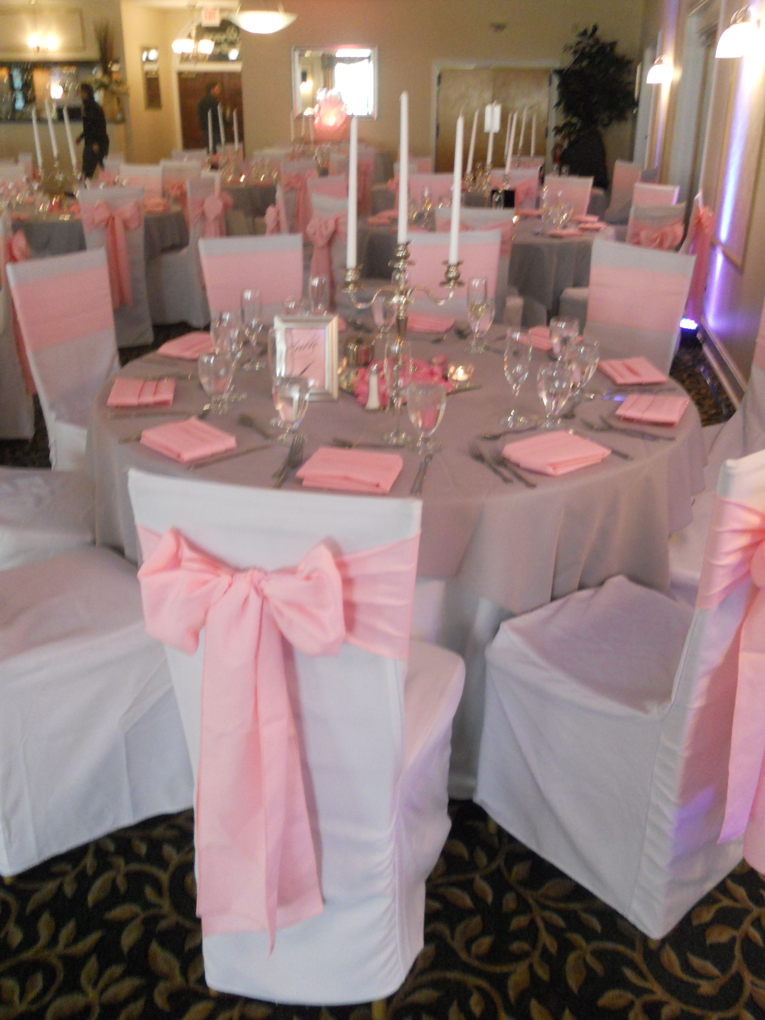 white chair covers with pink sashes Reception