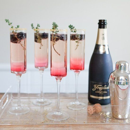 Blackberry Thyme Sparkler - Homemade blackberry simple syrup is the key to this gorgeous, ombre colored cocktail!