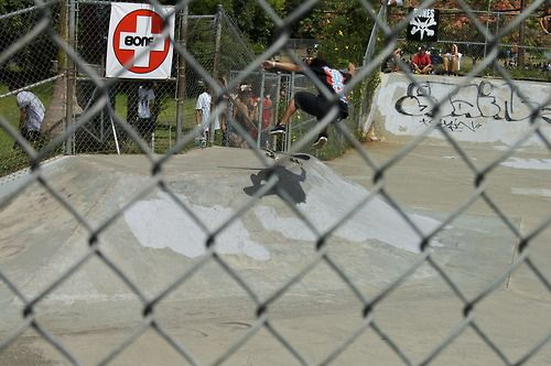 Kickflip the transition through a fence