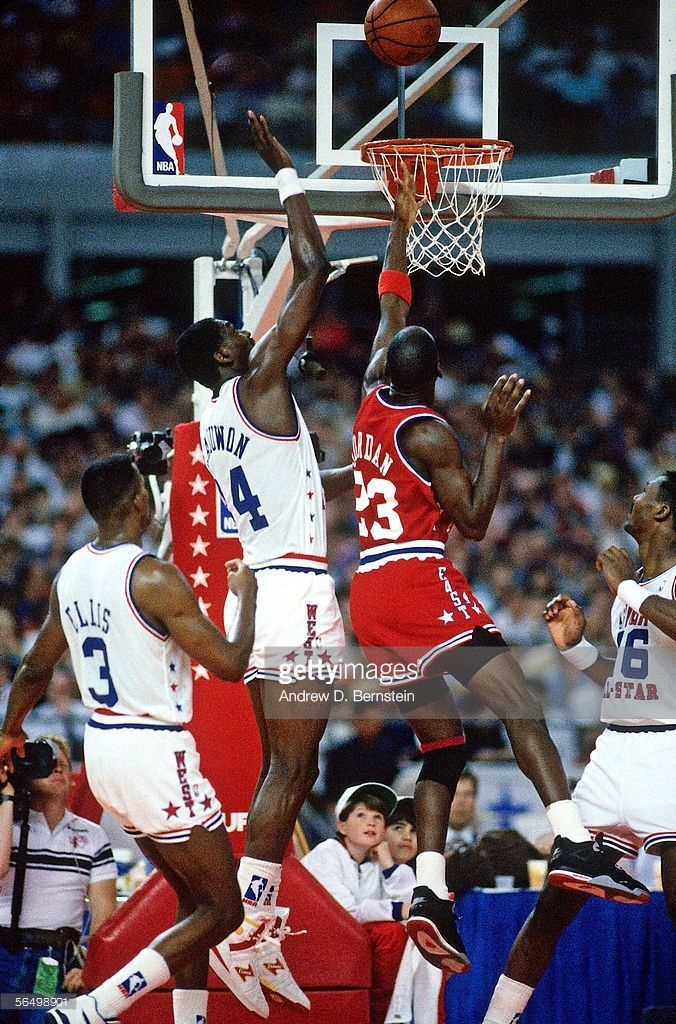693030fbc Michael Jordan  23 of the Eastern Conference All-Stars goes for a layup  over Hakeem Olajuwon  34 of the Western Conference All-stars during the  1989 NBA ...