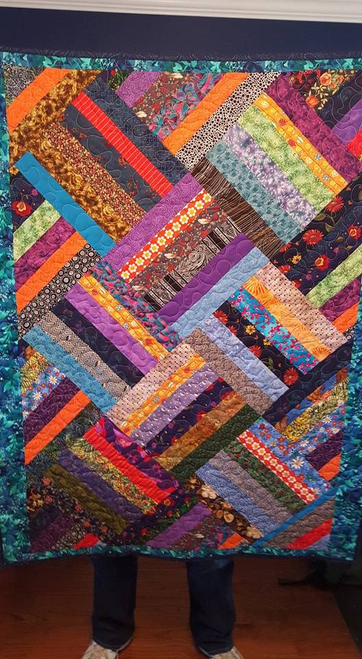 "This is the pattern ""Zigger Zag"" by Cozy Quilt Store owner Daniella Stout.  I have modified it to be 40"" x 50"""