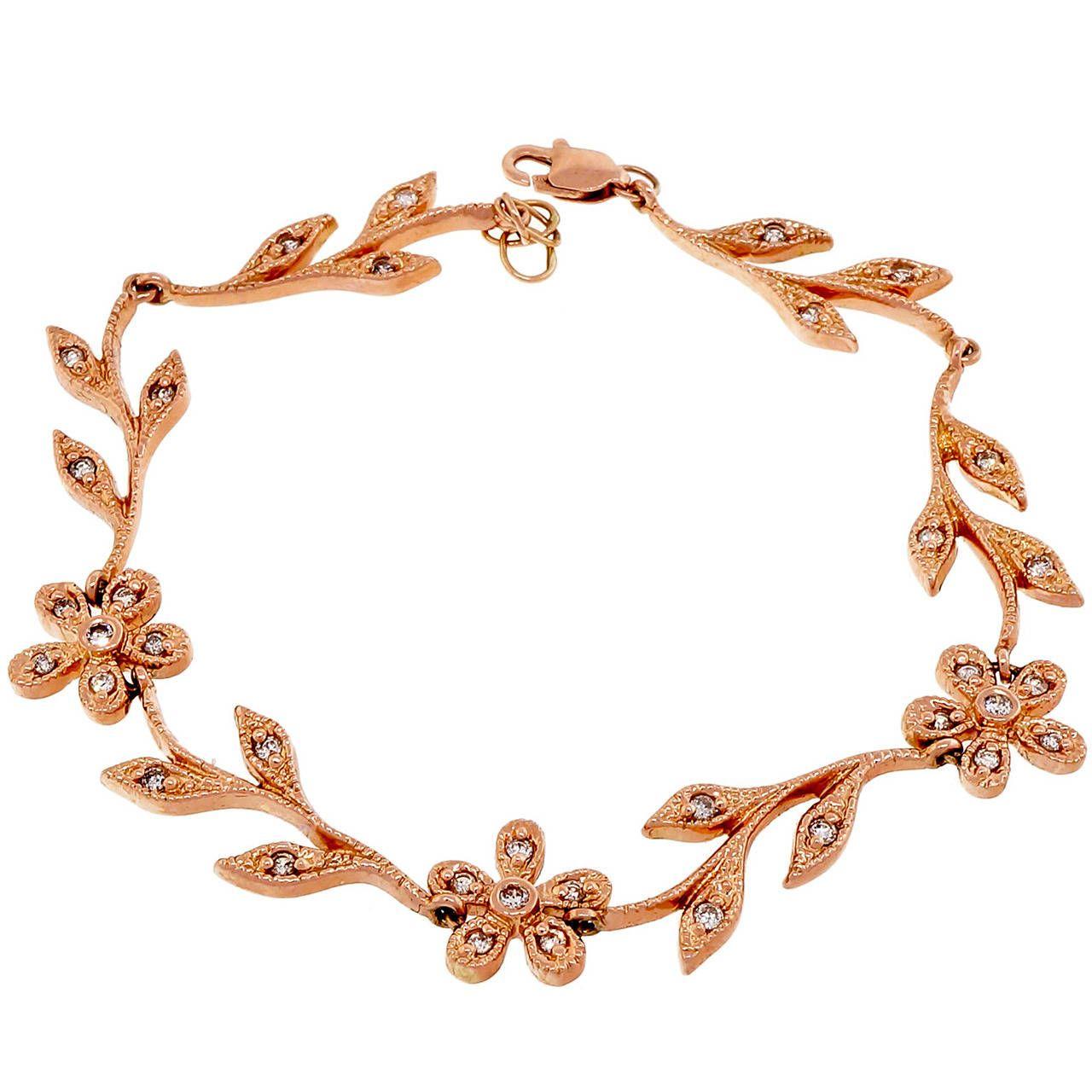Diamond Gold Flower and Vine Bracelet   From a unique collection of vintage modern bracelets at https://www.1stdibs.com/jewelry/bracelets/modern-bracelets/