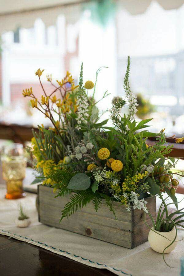 Like the wooden box and the almost wild look of the arrangement. Also the round yellow flowers (Louisa)