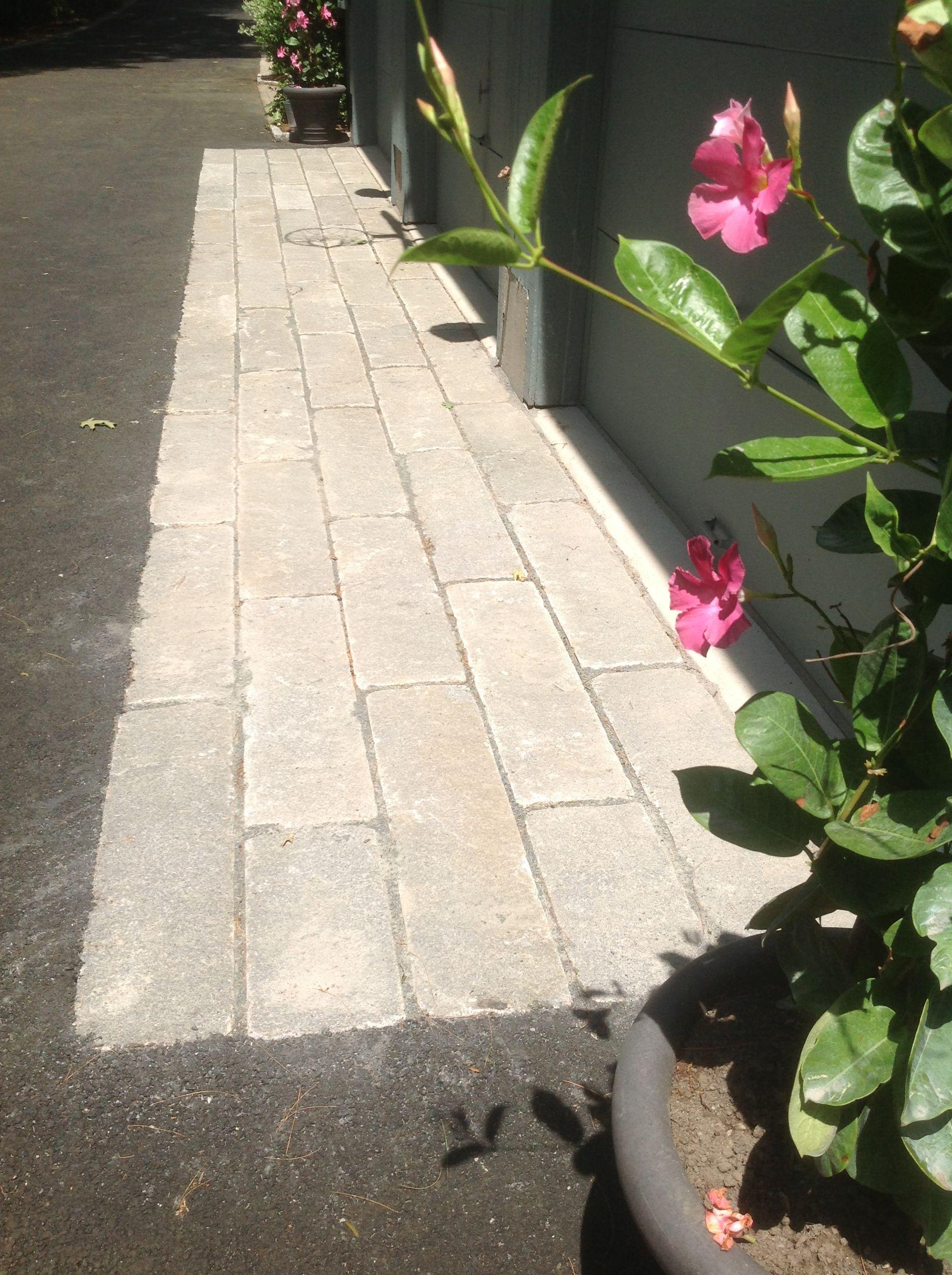Reclaimed granite curbing used in driveway apron