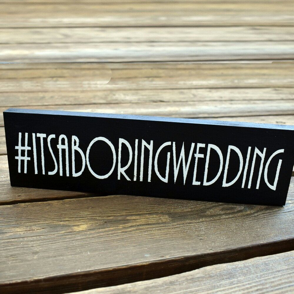 Get a sign with a memorable hashtag for your wedding