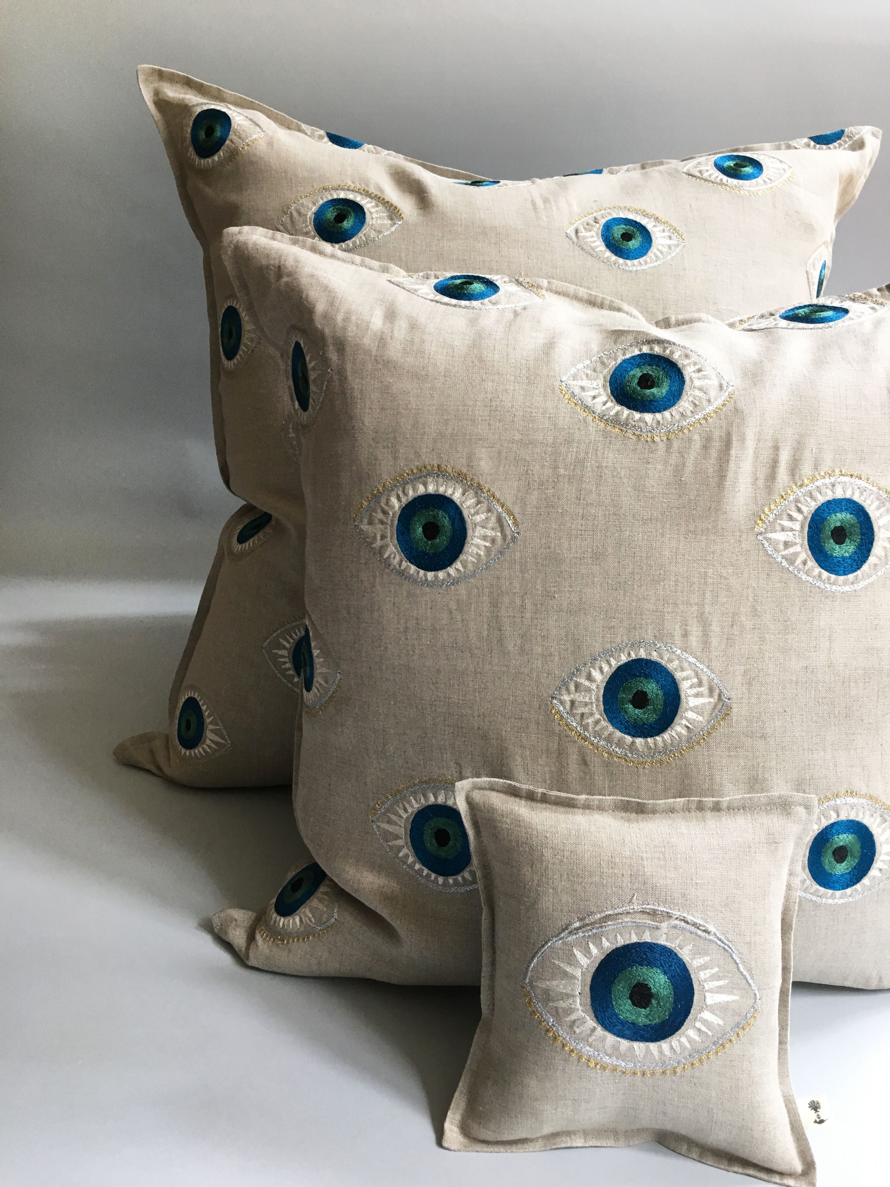 Coral and Tusk Evil Eye Pillows