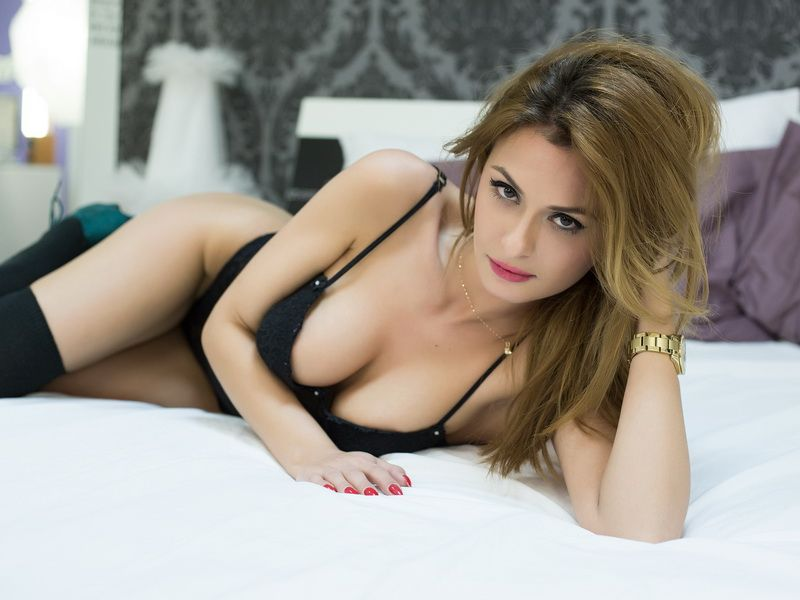 bulgarian webcam model jayden jolie wearing black lingerie while in bed