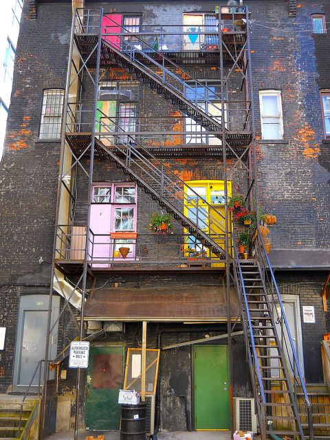 fire escapes and colourful doors - Not that we have doors up on our lofts - but we could paint windows with colorful curtains.