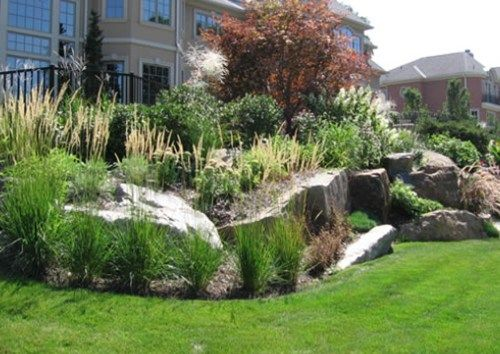 Where there is plenty of space available to take up grade  very large  boulders can provide both a high degree of stability and the beauty of  natural rock. Where there is plenty of space available to take up grade  very