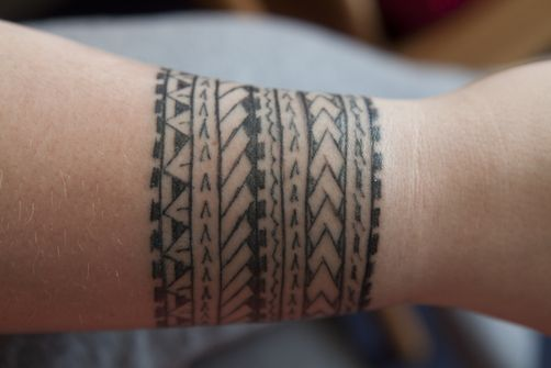 1404820 A Tourist With A Traditional Samoan Tattoo On Their Wrist With Images Polynesian Tattoo Polynesian Tattoo Meanings Tattoos
