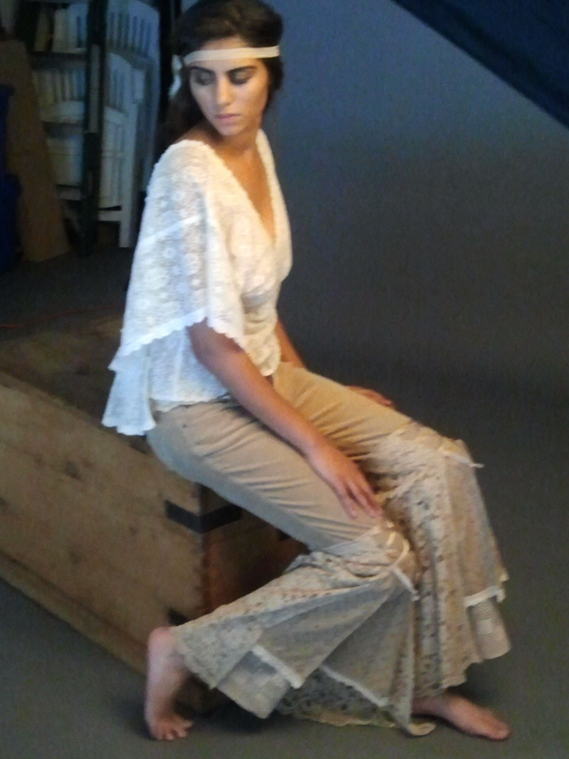 Lace top was a lace table cloth. Flared pants were recycled