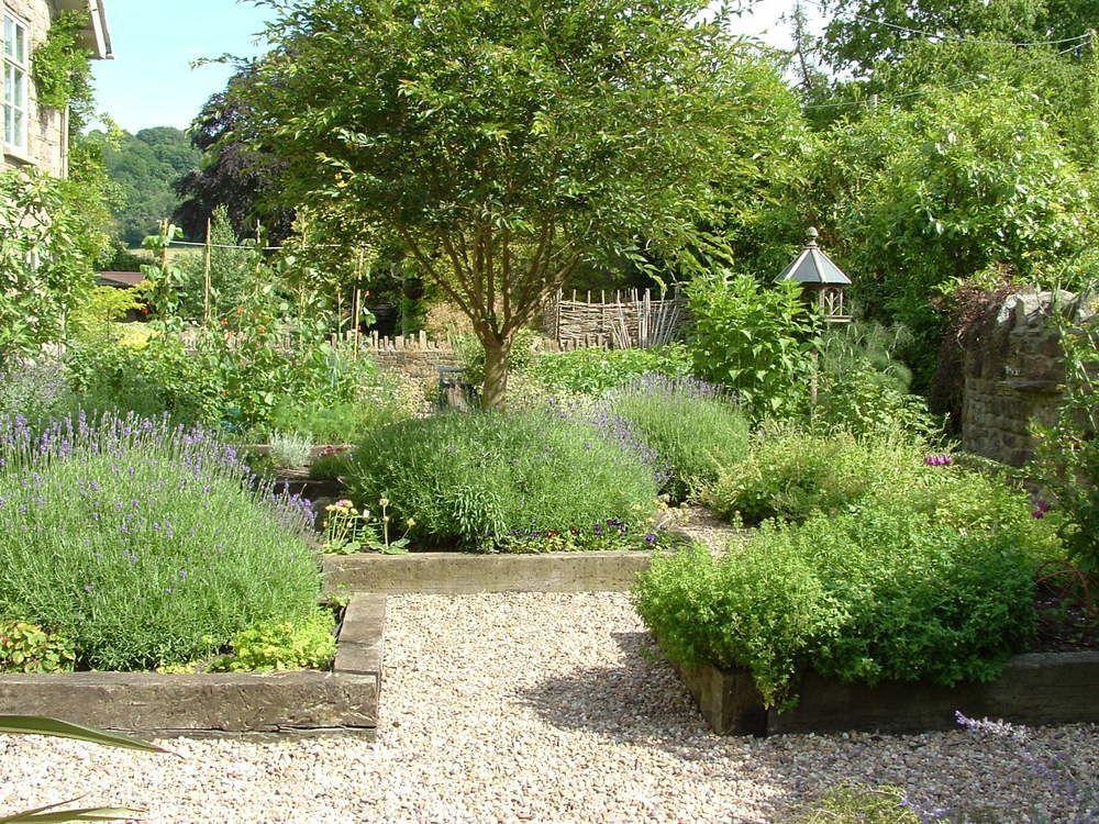 A Potager Garden Designed Using Timber Edged Raised Beds Around An Apple Tree Potager Garden Vegetable Garden Design Apple Tree Garden Design