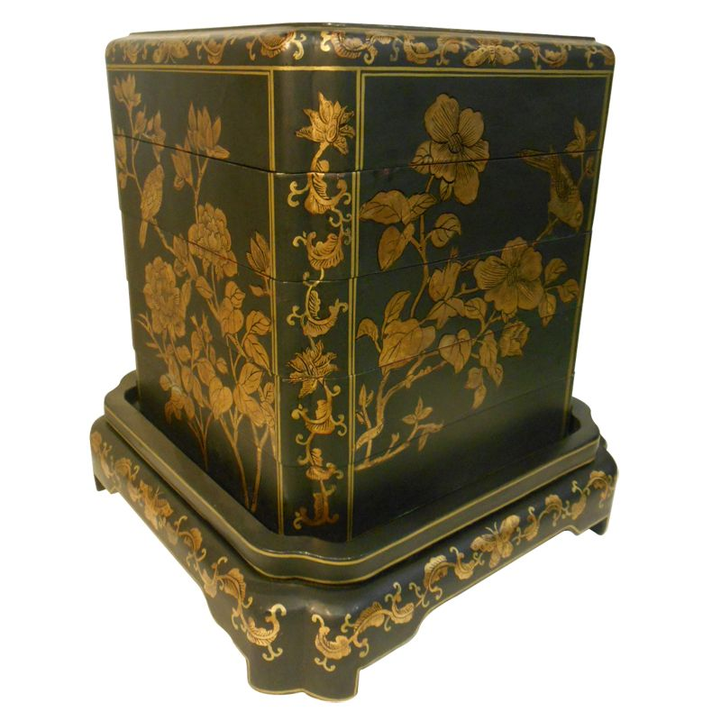 Hand Painted Oriental Black Lacquer Stacking Box, unusual in it shape and gold line bird & flower design. This lost art form of Chinese furniture building is called Coromandel and uses a technique of layering canvas and lacquer on to a wooden structure to make a smooth finish.